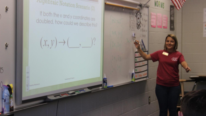 Mrs.Draghiciu in the classroom.
