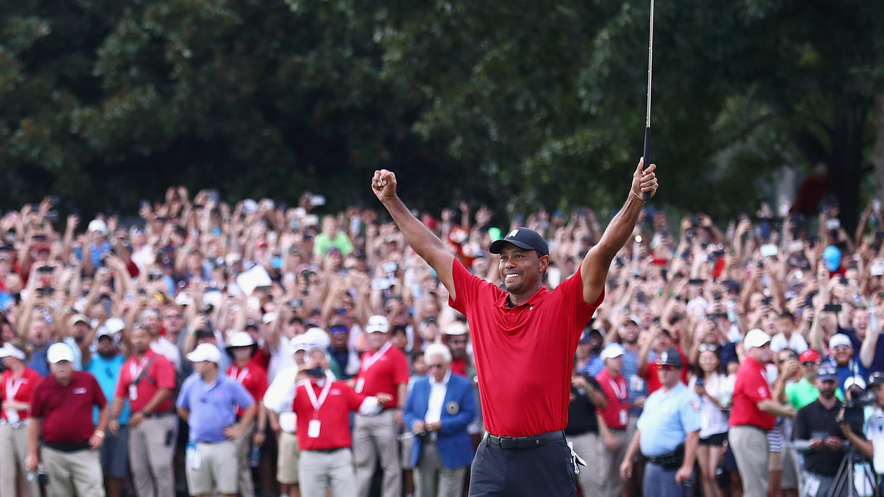 Tiger Woods celebrating his last hole victory.