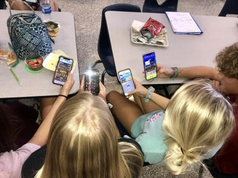 Jaci Bone, Kylee Schulman, Landon Depratter, and Ella Scott playing the new version of the Mario Kart game at lunch