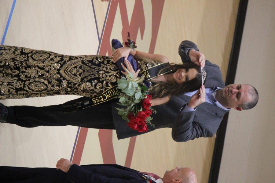 Kate Lewis is crowned freshman homecoming princess by Principal Lane.
