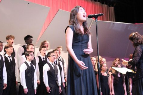 "Kayla Park 10, performing a solo of the song ""Sky Fall"" in the fall chorus concert"