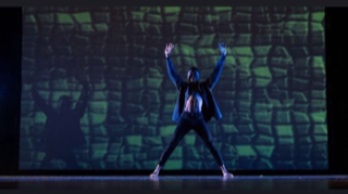 "Tyler Knowles dancing on stage in the the Mill Creek Fall Dance Show ""Iconic""."
