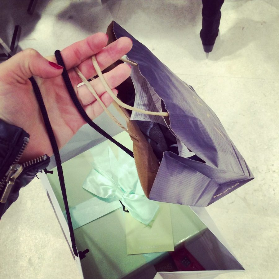 A picture of a person holding shopping bags commonly seen in a shopping mall