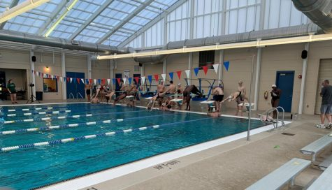 The Mill Creek swimmers on the block at team trials completing a 50 butterfly.