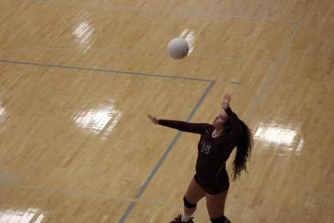 Melissa Braga, 9, serving the ball.