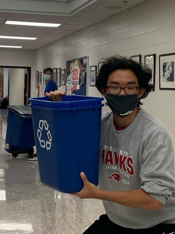 Cory Shin, 12, collecting recycles as part of a Environmental club activity.