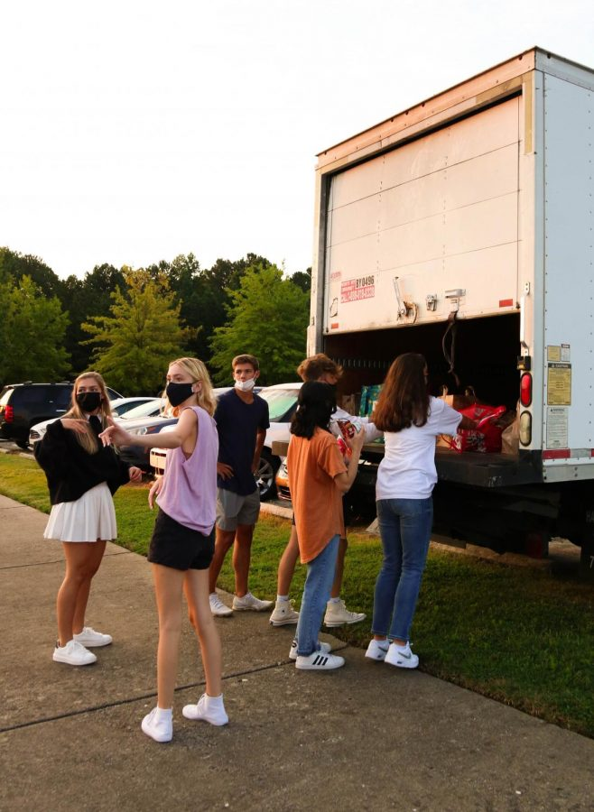 Students loading food donations onto the truck to be taken to the local food pantry. Lana Ivester, 10, Sadie Mcintyre, 12, Ridley Ivester, 11, Amani Sheikh, 12, Grace Gentzel, 12, Brendan Brannock, 12