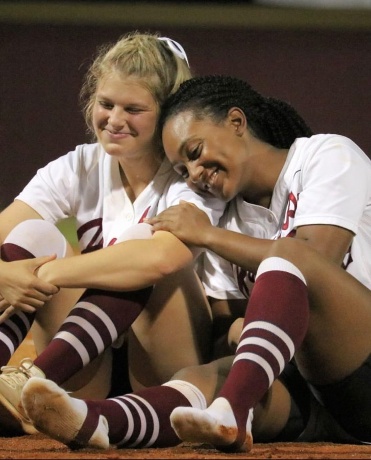 Varsity softball players Annalee Keys,12, and Lael Ayala, 12, embrace during the reading aloud of senior letters.